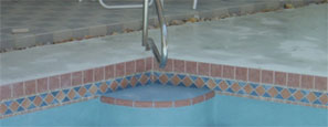 "4""x4"" flush cantilever above mosaic waterline tile"